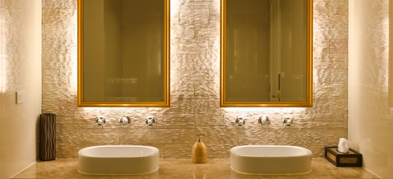 Modern Bathroom with Backlit Mirrors