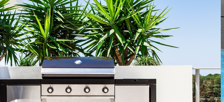 Outdoor Grill with Palm Trees in Background