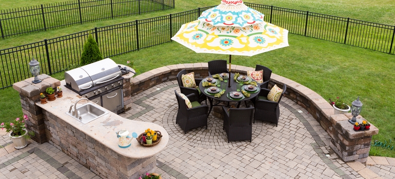 Outdoor Brick Patio with Grill and Furniture