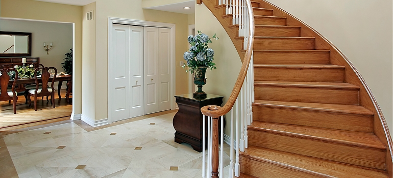 Tile Entryway with Curved Stairway