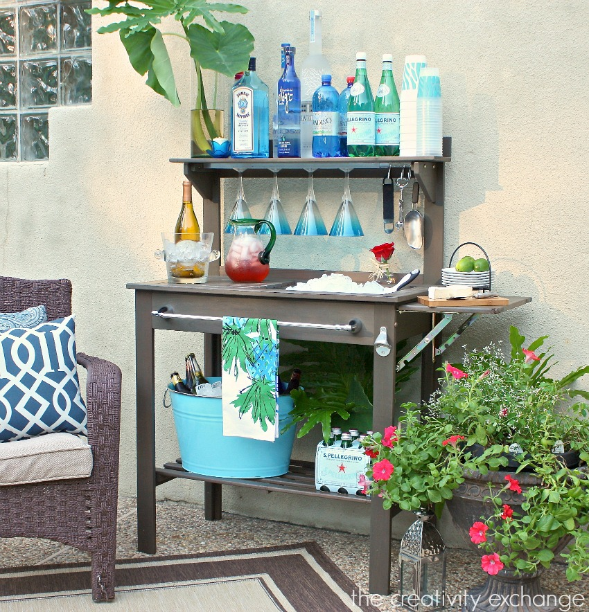 Inexpensive-potting-bench-turned-into-an-outdoor-bar-and-beverage-station-for-entertaining.-The-Creativity-Exchange