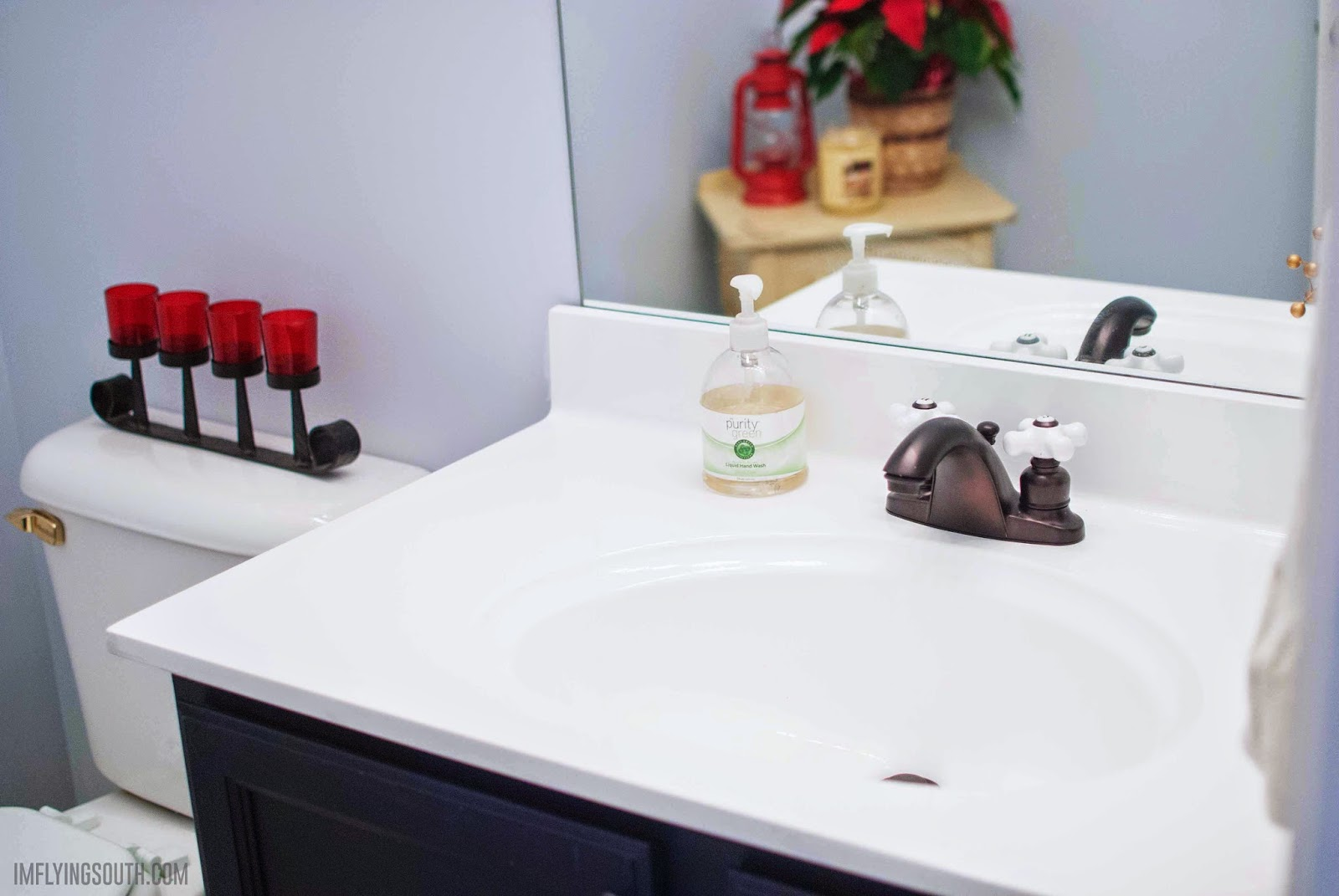 inexpensive-painted-bathroom-sink-makeover-Im-Flying-South-featured-on-@Remodelaholic