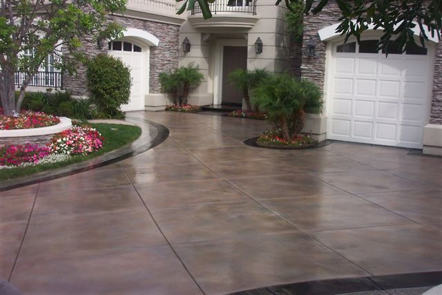 cut-and-stained-concrete-driveway