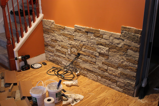 Stone accent wall diy air stone wall in a living room renocompare they started the project by thoroughly cleaning the wall surface and with the power cut off dismantling an existing flat tv mount and removed an existing sciox Choice Image