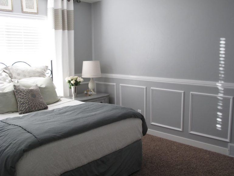 Photo of bed and window with chair rail molding