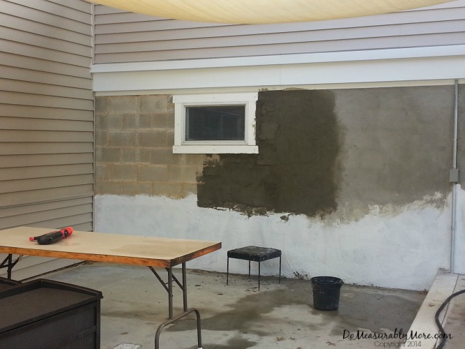 The creation of their stucco look patio wall
